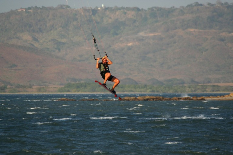Kiteboarding and kitesurfing school professional instructor costa rica top wind destination of central america bahia salinas landing after some big air.jpg - big